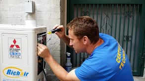 Technician performing maintenance for ductless mini split system